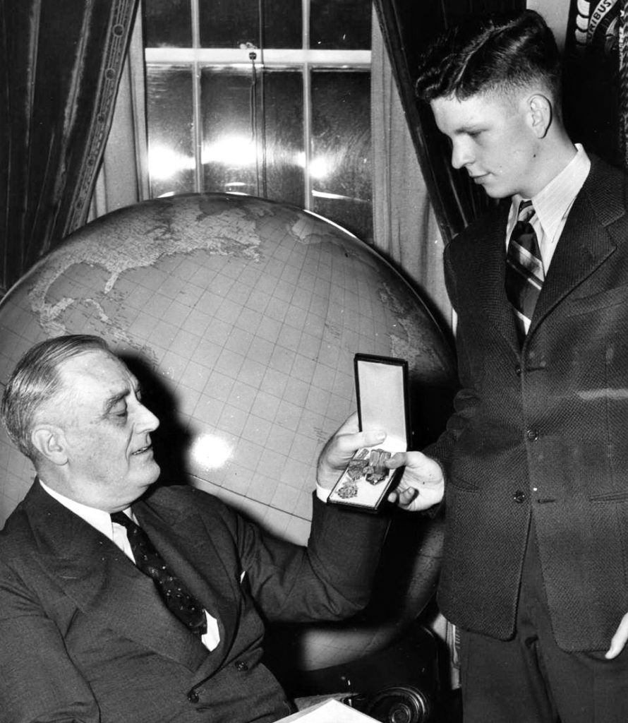 President F. D. Roosevelt presents the Medal of Honor to Kenneth N. Walker, Jr.